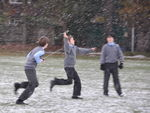Boys flying their radio controlled glider in the first snow of the year.