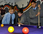 Some year 7's try out their newly recovered pool table in their Common Room.